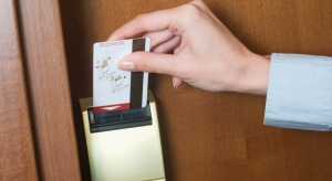detail-of-young-businesswoman-opening-door-to-hotel-room-with-key-card-2